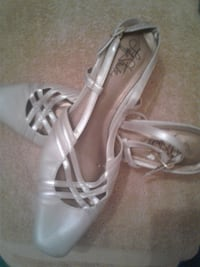 pair of white leather open toe ankle strap heels Rockville