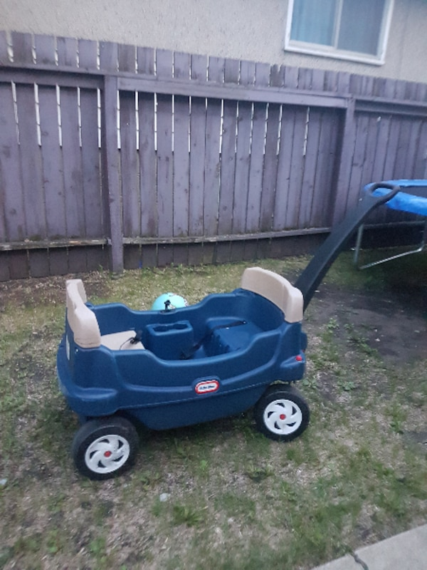 blue and black Little Tikes cozy coupe
