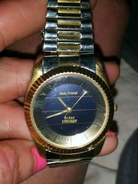 round silver- and gold-colored Waltham analog watc