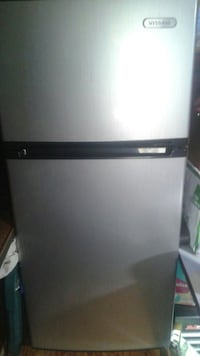 gray and black top-mount refrigerator