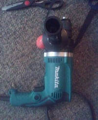 black and teal Makita corded drill