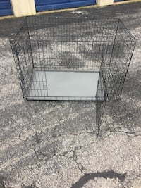 Large dog cage in good condition ! Clayton, 08312