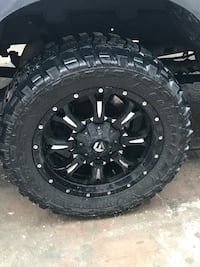 black multi-spoke vehicle wheel with tire