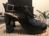 pair of black leather heeled booties New York, 11103