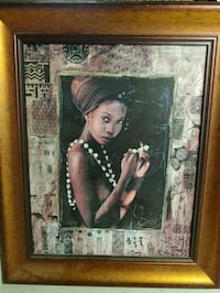 brown wooden framed painting of woman St. Catharines, L2R 5M4