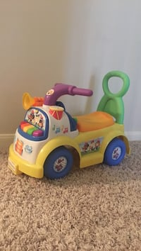 yellow and white ride-on toy
