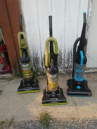 two green and one yellow upright vacuum cleaners Baraboo, 53913