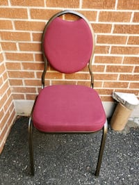 Burgundy stackable banquet hall chairs.   Toronto, M1T 1T5