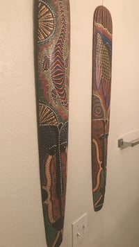 two brown-red-and-orange tribal wall decors