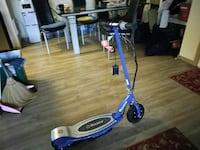 blue and silver Electric Razor scooter