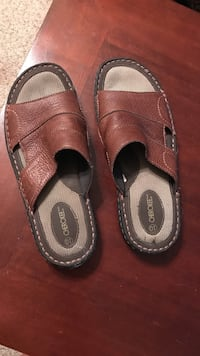 Pair of brown leather slide sandals