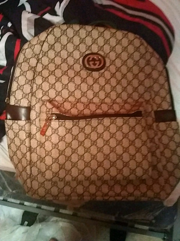 e309df995117 Used brown and white Gucci backpack for sale in Lithonia - letgo