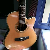 brown and black acoustic guitar Shillong