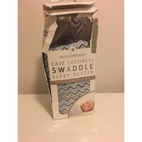 Brand new in packaging ease fussiness swaddle blanket Toronto, M9L 1H1