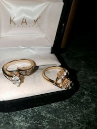 two gold-colored clear gemstone encrusted rings with box Douglasville, 30134
