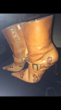 Pair of brown leather heeled boots