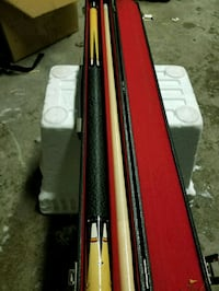 black and beige cue stick with case