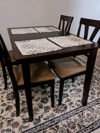 Brown dining room table and chairs set