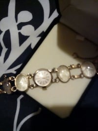 round white analog watch with link bracelet