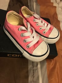 pair of pink-and-white Converse low-top sneakers with box