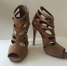 pair of brown leather open toe cutout heels