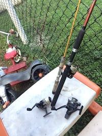 two black and gray fishing reels