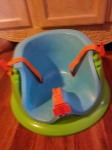 Green and blue baby seat