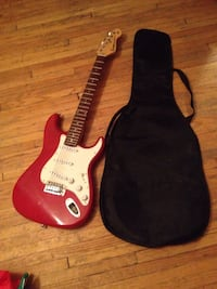 Red and white stratocaster-style electric guitar Saskatoon, S7M