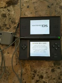 Red Nintendo DS with power supply.  Laval, H7S 1L4