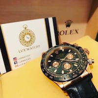 round black Invicta chronograph watch with black leather strap Montréal, H3R 2H2