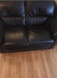 Black leather sofa and love seat set