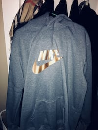 gray and white Nike pullover hoodie