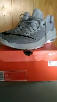 unpaired gray and white Nike running shoe Phoenix, 85033