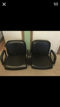 Two black leather rolling chairs