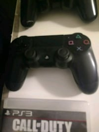 black Sony PS4 game controller Milton, L9T 7E3