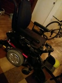 black and red motorized wheelchair 56 km