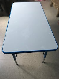 Blue wooden table 4x2 adjustable height. New York, 10467