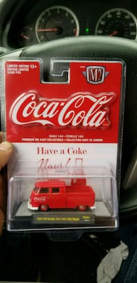 red and white Coca-Cola plastic toy pack 2257 mi