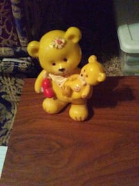 yellow and red bear plush toy