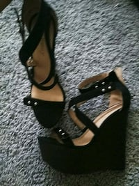 pair of black leather open-toe ankle strap heels Denver, 80204