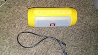 tubular yellow JBL portable Bluetooth speaker with USB cable