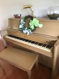Limed oak upright piano with bench. Made by Stark. Annapolis Junction, 20701