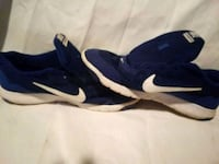 pair of blue-and-white Nike running shoes