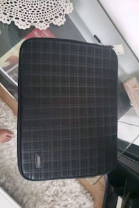 Roots laptop case brand new