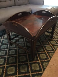 Solid wood drop leaf tray top coffee table. Surface could be refinished. Cleveland