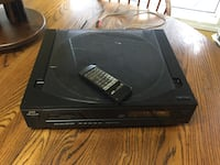 Black jvc compact disc player and remote control