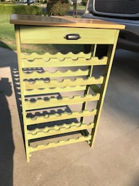 Chic wooden tall wine rack with 1 drawer holds 36 wine bottles it measures- 40 inches tall 33 inches wide ; 13 inches deep Fresno, 93711