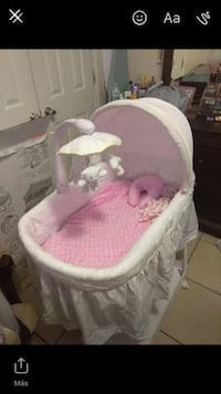 baby's white and pink bassinet San Antonio, 78229
