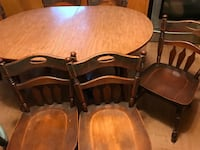 oval brown wooden 4-piece dining set Breaux Bridge, 70517
