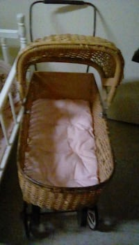 baby's brown and white bassinet Albuquerque